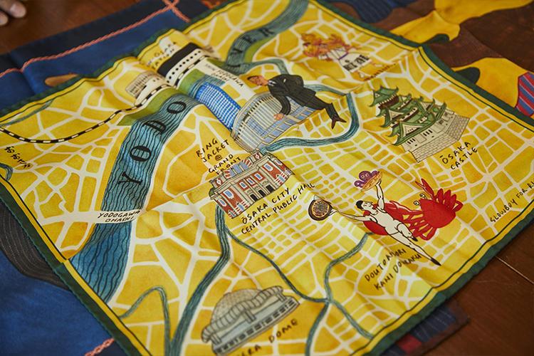 大阪の地図に名所のイラストを添えたものも準備中。こちらは今年10月、グランフロント大阪にリングヂャケットが新たにオープンするのを記念した非売品。ノベルティとして数量限定で用意される。 ※本品はオープニングのスナップイベント参加者にプレゼントされる。