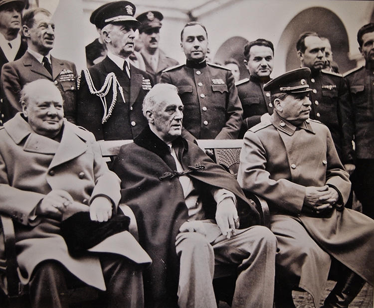 President Franklin D. Roosevelt wearing a BROOKS BROTHERS cape at the Yalta conference.