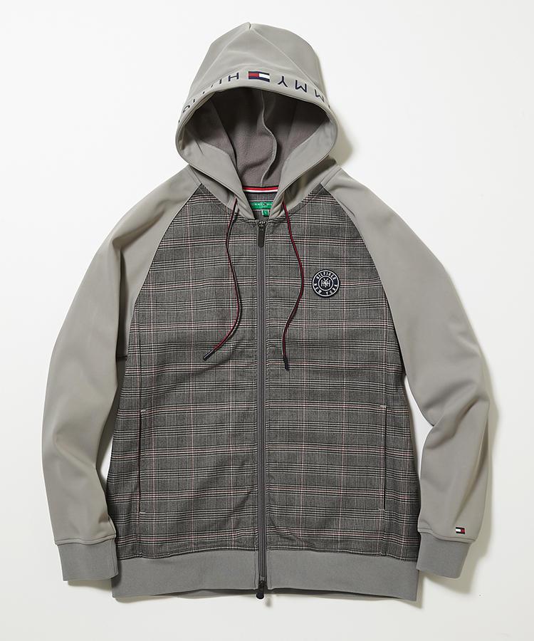 <strong>トミー ヒルフィガー ゴルフ</strong><br />英国柄をカジュアルに取り入れられる、グレンチェック使いのパーカジャケット。裏地は肌に優しいフリース素材。見た目薄手ながら、保温性と防風性に優れている冬仕様だ。2万円(ヤマニ)