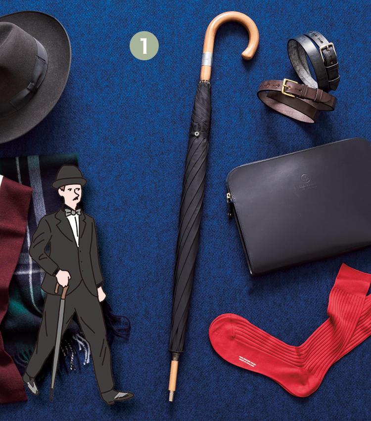 細巻きをステッキのように持ち歩く<br><span style=font-size:1.1em;><strong>一本傘</strong></span><br><br><strong>《1》フォックス・アンブレラの一本傘 / FOX UMBRELLAS</strong><br>天候の変わりやすい英国では、必需品の一つである傘。英国紳士たる者、細巻きの一本傘をステッキのようについて歩く。紳士の風格を演出できるアイテムだ。《1》ウォルナットの木から彫り出したシャフトを基に、クラシカルな8本骨のダブルフレームでできている。7万9000円(ヴァルカナイズ・ロンドン)