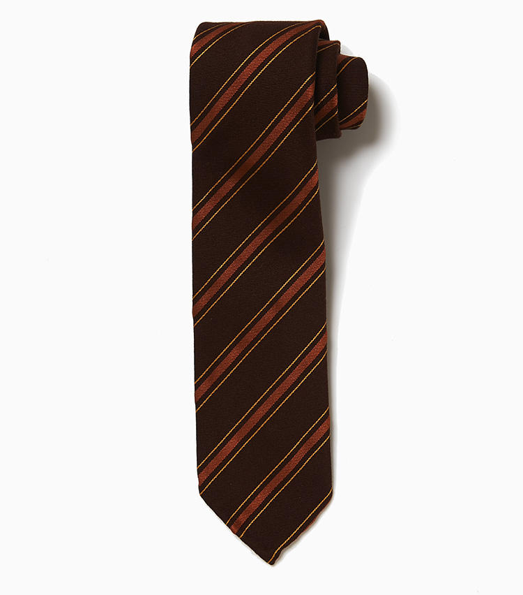 <b>11.サルヴァトーレ ピッコロのストライプタイ</b><br />ウール・シルク・コットン三者混素材によるストライプタイ。ブラウン、オレンジ、イエローといった暖色を用いた柄はヴィンテージ調な趣。渋さのあるVゾーンを作りたいときにうってつけだ。大剣幅は7.5cmと細めで、裏地なしの仕立て。軽快感のある雰囲気も魅力だ。1万6000円(ラ ガゼッタ 1987 青山店)