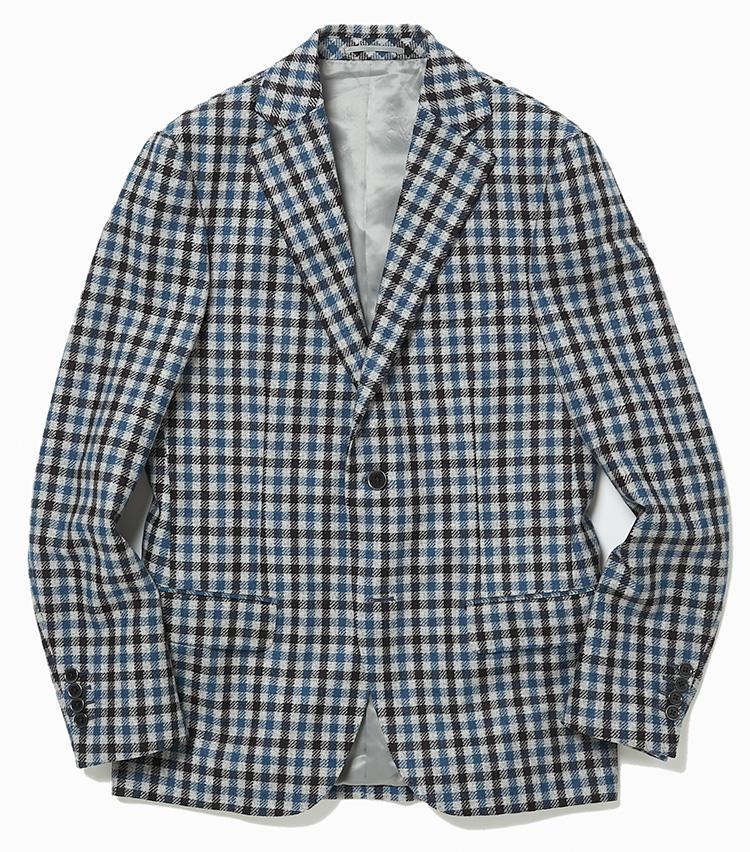<b>3.デザインワークスのブルーのチェックジャケット</b><br />イタリアのカノニコ社のシェパードチェック生地によるジャケットは、多色使いでも落ち着いた印象。ビジネススタイルの基本色、ブルーベースである点も着回しやすい。8万9000円(デザインワークス)