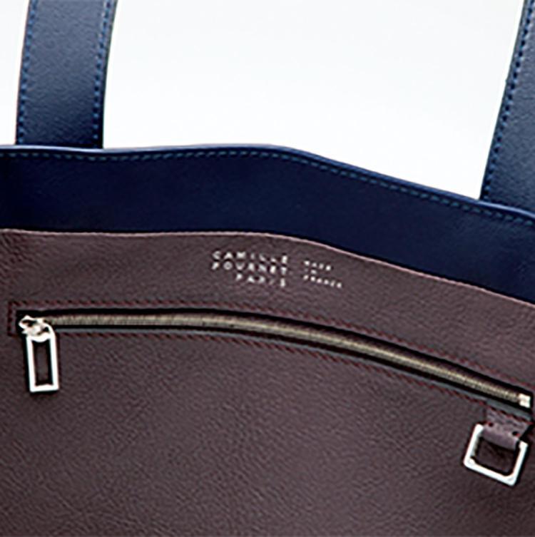 <b>革のよさを存分に引き出すシンプルな作り</b><br />内側にはシンプルなジップポケットを配置。美しい金具パーツもポイントだ。コンビカラーのシェーブルレザーで内張りされている。