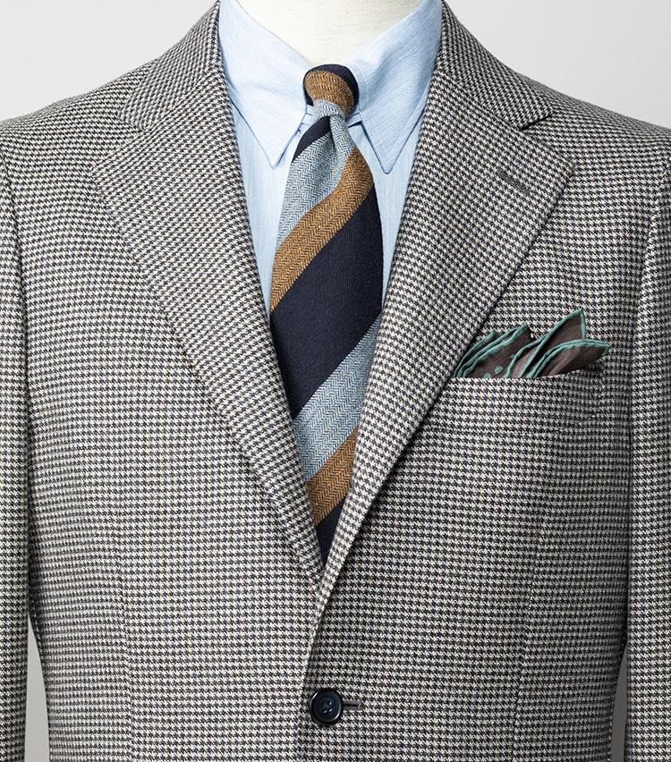 <p><strong>「NO残業デー」仕事終わりに約束アリの日は何を着よう? </strong></br><br /> 夜に出かける予定がある日は、スーツよりも気楽なジャケットスタイルがベター。ライトブルーやブラウンが入った千鳥格子柄のジャケットを軸に、同系色のシャツ、ネクタイ、チーフを合わせてリンクさせれば、きちんと感のなかに遊び心のある着こなしになる。</p> <p><small>ジャケット5万円/シップス、シャツ2万6300円/エリコ フォルミコラ、ネクタイ1万9000円/ニッキー、チーフ6300円/フィオリオ</small></p>