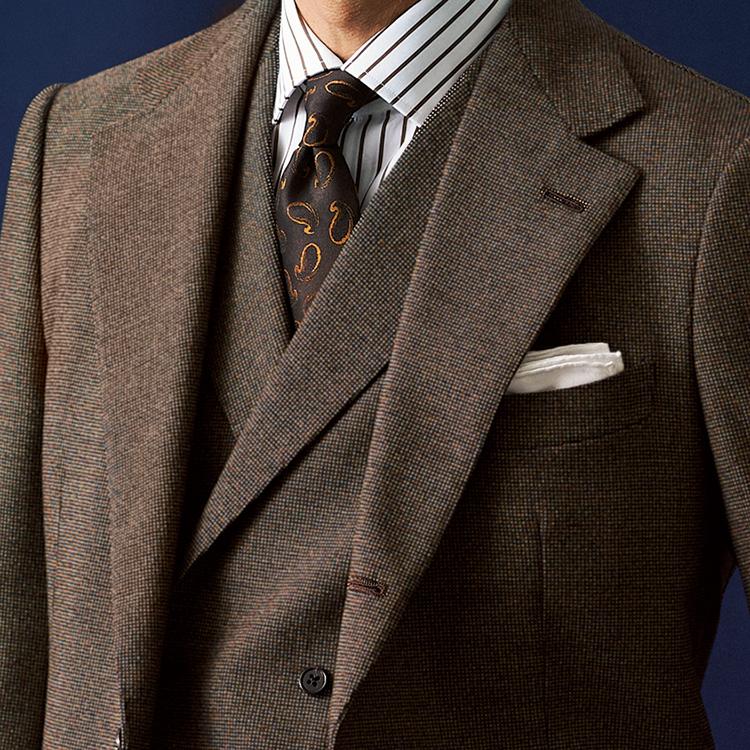 <p><strong>7位<br />スーツでエグゼクティブ感を出すなら、こんな色!【1分で出来るスーツのお洒落】</strong><br />ネイビーやグレーのスーツに飽きたら、第3の定番色としてブラウンスーツに挑戦してみよう。少しメランジ感のあるブラウンスーツは、ほのかな色気が漂い、さらにダブルベストの3ピースで着ると貫禄も生まれる。合わせるネクタイも大柄のブラウンペイズリーなどで渋めに。仕事の出来そうなエグゼクティブ感ある胸元を演出することができる。<small>(2019年12月号掲載)</small></p>