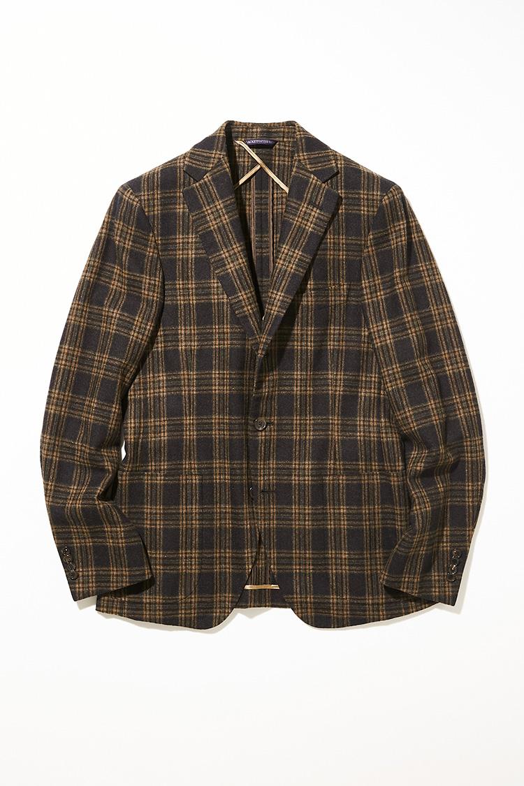 <p><strong>ベルヴェスト</strong></br>ブラウン×ベージュの温かみのあるウール100%で仕立てたジャケト イン ザ ボックスは、トゥモローランドの別注生地。副資材の少ない軽快なアンコン仕立てと、仕上げに製品染めを施しているのが特徴で、寛いだ着心地が魅力だ。これ一着で様々に着回せるようにも配慮されていて、タイドアップはもちろんノータイやタートルにも馴染むよう着丈やシルエットが調整されている。18万8000円(トゥモローランド)</p>