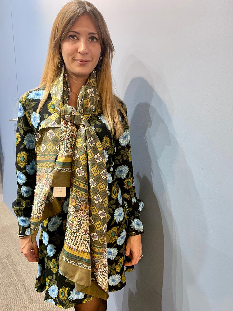 <p><strong>13.  Stefano Cau scarf / ステファノ・カウのスカーフ</strong><br /> I like garments with a story.  This lightweight scarf worn by Giorgia is made of habutai silk (literally translated to feather-two-layer)<br /> The pattern was inspired by the tile work on an Armenian church which Stefano and Giorgia visited  on a recent trip to Israel.  A gum finish was added to soften the fabric and mute the colors.</p> <p><small>私は、ストーリーのある服が好きです。ジョージアが身につけている薄手のスカーフは、羽二重シルクからできています。この柄は、ステファノとジョージアがイスラエル旅行で最近訪れたアルメニアン教会のタイルからヒントを得ています。生地を柔かくし、色調を抑えるための加工が施されています。</small></p>