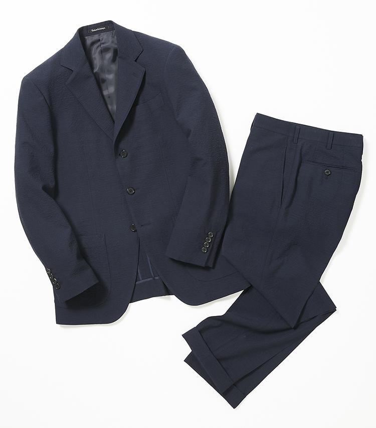 <p><strong>タカシマヤ イージーメード</strong></p> <p>ビジネススーツの王道、ネイビー無地のウールシアサッカーもラインナップ。シルクプロテイン加工と呼ばれる特殊仕上げにより、肌触りの滑らかさをさらに高めている。織物の名産地として知られる尾州産の素材だ。11万円〜〈オーダー価格、納期約4週間〉</p>