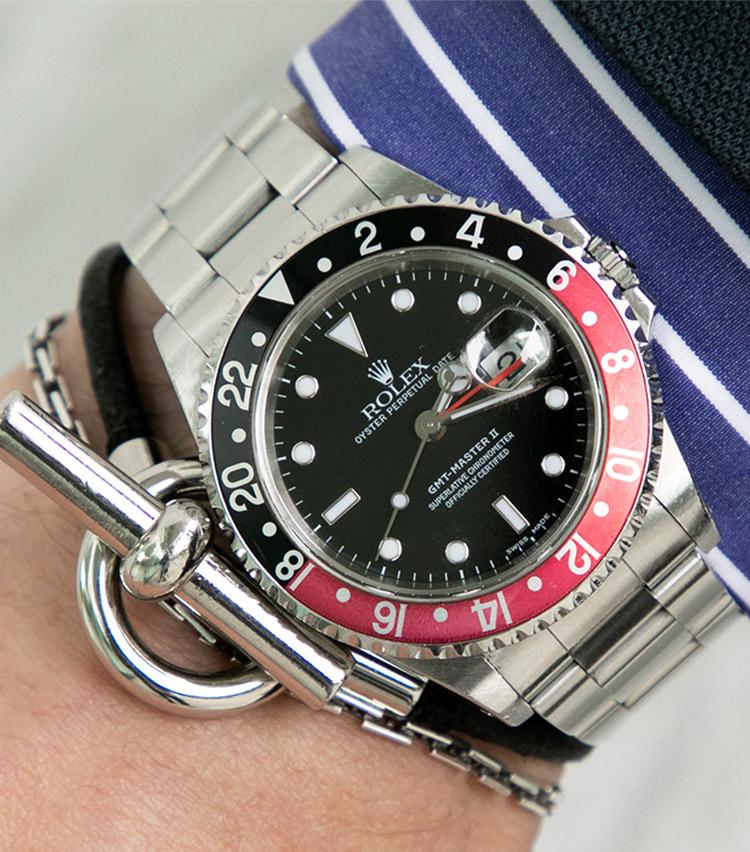 <p><strong>ストラスブルゴ事業部 ブランドマネージャー 兼 販売支援部 部長 門石貴幸さんの愛用時計(1)<br /> ロレックス/GMTマスターⅡ 16710</strong></p>