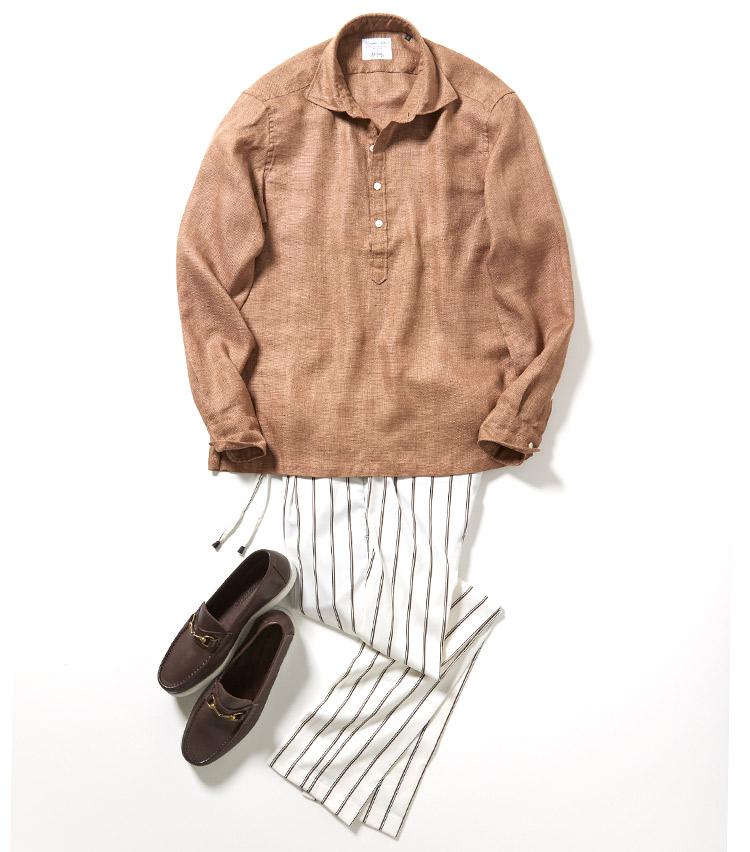<p>パンツの柄と靴にブラウンを取り入れて、シンプルながら使う色を二色に絞って全体にまとまりを生み出している。同じブラウン系でも色の濃淡をつけることで、コーディネートに奥行きが生まれる。<br /> <small>パンツ3万円/ジャブスアルキヴィオ、靴3万4000円/イルモカシーノ</small></p>