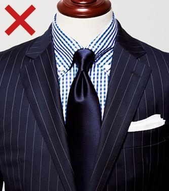 <p><strong>【これはNG】<br /> 素材感や印象が大きく異なるものを合わせると統一感のない印象に</strong><br /> 上品な光沢が映えるシルクタイは起毛感ある紡毛のスーツ地では、質感のコントラストが強すぎ、ちぐはぐさが際立ってしまう。カジュアル見えするBDシャツなども不似合いだ。</p>