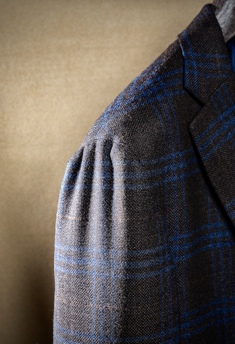<p>The shirring at the sleeve head, achieved by hand sewing, allows for comfort and freedom of movement.  It also creates the sublime waterfall effect so coveted by the cognoscenti.</p>