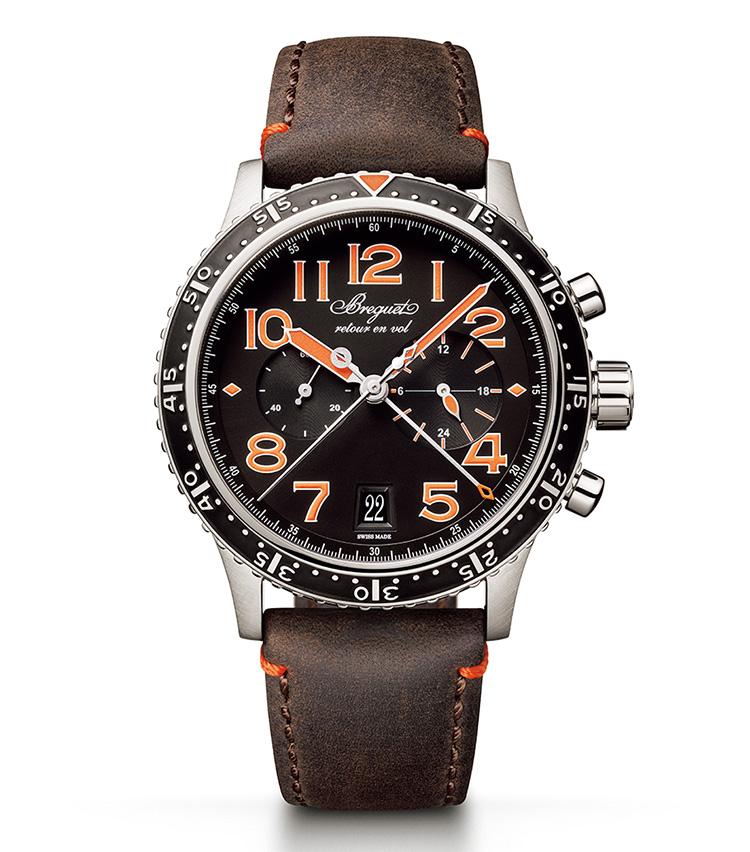 <p><b>BREGUET(ブレゲ)<br /> タイプ トゥエンティワン 3815</b><br /> <br /> <b>ヴィンテージな佇まいに目が覚めるような色を差す</b><br /> 1950年代から続く航空フライバッククロノの名作が、鮮やかなオレンジカラーをまとった。ダイヤルは、サンバースト仕上げのディープブラックとし、色を強く対比させた。センター同軸に置くクロノグラフ針は、秒と分の各積算計。世界限定250本。自動巻き。径42mm。チタンケース。カーフストラップ。177万1000円(ブレゲ ブティック銀座)</p>